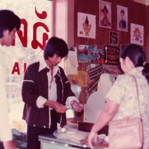 man attending register